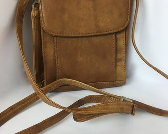 Brown cross body purse with multiple compartments
