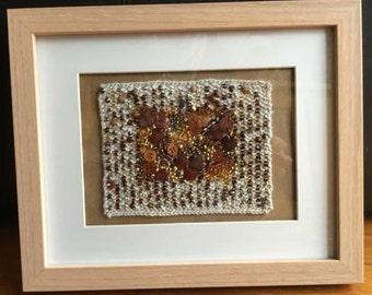 Hand knitted and embellished, framed artwork