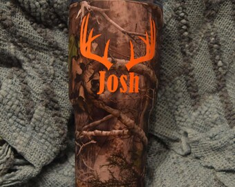 PersonalizedCamo RTIC with orange Deer antlers and name