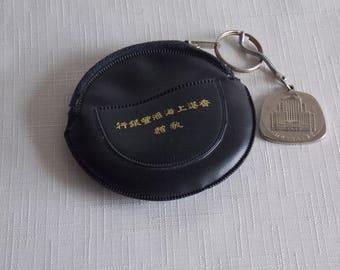 Purse and key fob, Hong Kong and Shanghai Bank.