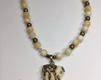 Ivory colored small elephant necklace