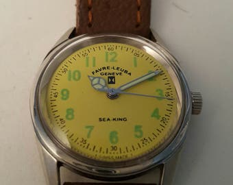 Vintage FAVIE LEUBA midi size Swiss made watch with attractive yellow face circa 1965---------SERVICED--------