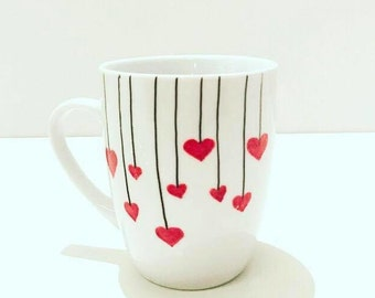 cup of hand-painted with a series of heart