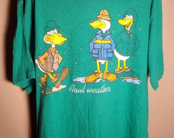 "80s Graphic Ducks Novelty Large Green Super Shirts Soft Tee ""FOUL WEATHER"" Funny Humor Comic Strip Oregon Seattle Washington USA Dad Joke"