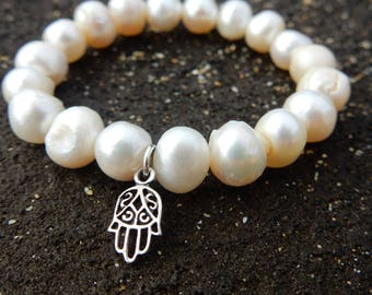 White pearl stretchy bracelet with sterling silver hamsa hand