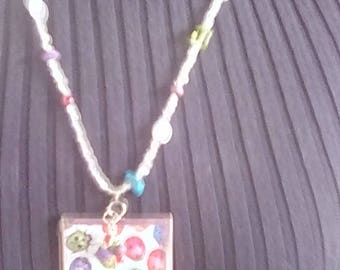 Fun multi color ladybugs glass pendant on a colorful beaded necklace