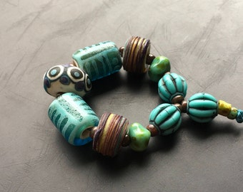 Handmade lampwork glass bead set by Lori Lochner purple teal one of a kind tribal glass beach bead set artisan jewelry making supply