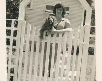 Vintage Snapshot photo 1930s Young Lady Holds Spaniel Dog in Front of Home