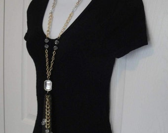 Vintage 23 inch center drop Mirrored Pendant w/ 6 and 1/2 inch long tassels, 11 various gold tone metal chains & clear faceted beads