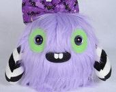 Maiken the MonsterFriend unique furry monster plush lavender fur with bat print headbow, black and white print arms