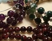 RESERVE Listing for Farrah3, 4 Custom Rosary Bracelets