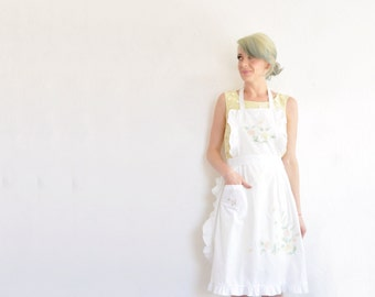 1960 pastel flower ruffle pinafore . embroidered baker apron .small.medium.large