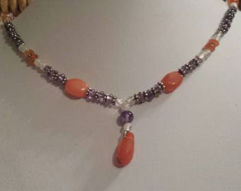 A delicate gemstone necklace with Amethyst Carnelian and Clear Quartz Crystal stones