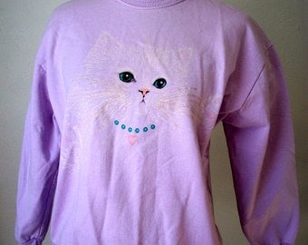 Purple sweatshirt with glitter white cat face wearing blue pearls - by Morning Sun