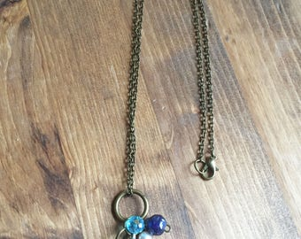 Upcycled Charm Necklace: Freshwater Pearls, Antique Bronze Anchor, and Blue Glass Beads