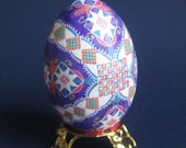 purple pisanka Ukrainian Easter egg batik decorated chicken egg shell Pink and purple ornaments for Easter tree