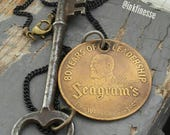 Seagrams Gin - 1937 vintage solid brass brand coin, steel skeleton key & black sealed link chain necklace