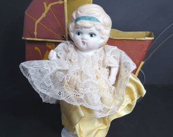 Vintage Bisque Doll, Kewpie, Jointed Arms, Blonde Hair, Frozen Charlotte Style Legs, Yellow Dress