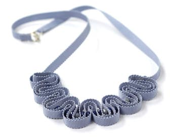 Blue ribbon necklace with navy and grey glass beads