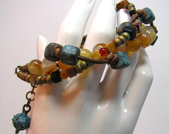 Ancient Peace -  Carnelian Mykonos Ceramic Onyx  and rustic brown leather bracelet