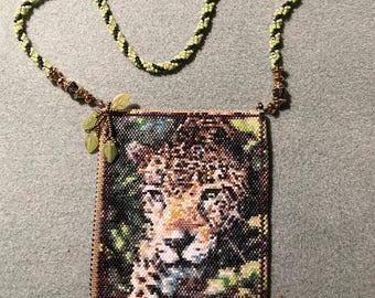 Handwoven beaded amulet bag