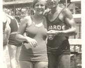 """Vintage Snapshot """"Photo-Op With The Hunky Life Guard"""" Cute Girl Handsome Man Biceps Found Photo"""