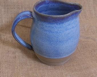 Stoneware jug glazed in blue beige.