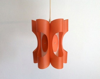 Pendant light orange and white folded plastic or bent plastic. For ambient lighting. Vintage Scandinavian design.