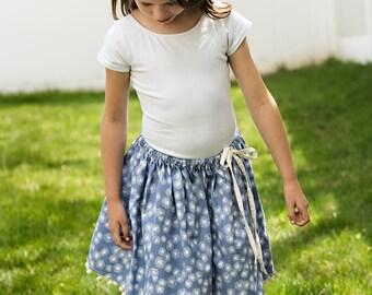 Girls twirly blue dandelion skirt with pompom trim, ball fringe, tie waist, sizes 12 m to 12 years periwinkle