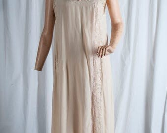 1940s or 50s Vintage silk nightgown, Vee neck, beautiful lace at neck and along the side. Small pocket. Very good shape.