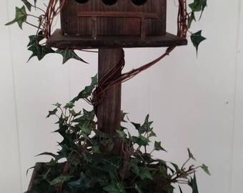 vintage handmade bird house with stand