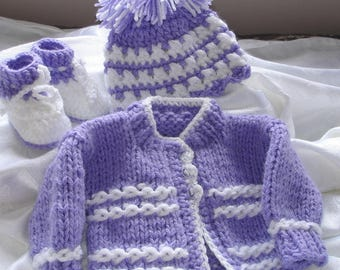 Custom hand knit baby girl sweater set. Original design by kids knits.