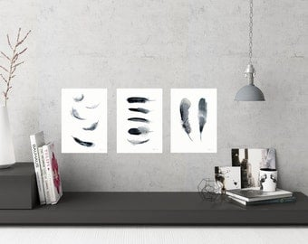 Black feather art print set of 3 watercolour paintings. Classic, simple and modern wall art that will last beyond trends. Buy 2 get 1 free