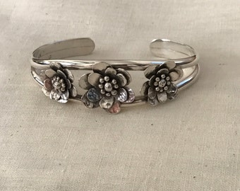 Silver Cuff Bracelet With Three Flowers
