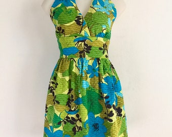 Adorable 1970s bright and bold floral print halter dress with gathered waist
