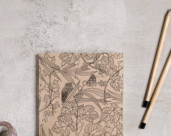 Illustrated notebook cover with blank organic pages