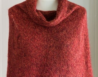 This cape is 'The Supersized Hug' - a super soft and warm capelet or poncho, hand knit with a super kid mohair & silk yarn in orange red
