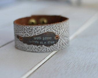 Distressed leather bracelet with hand stamped angel wing 'with brave wings she flies'