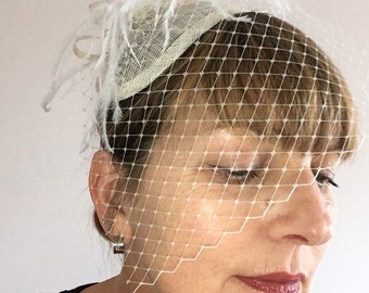 Ivory Sinamay Teardrop Fascinator with Ostrich Feather, Ribbon and Vintage Brooch detail