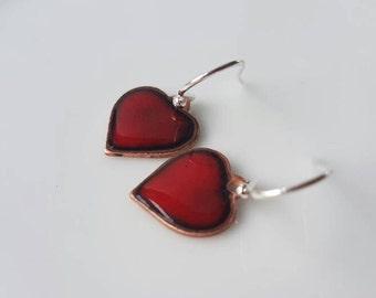 Copper heart earrings on sterling silver ear wire.