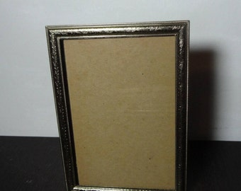 Vintage 5 x 7 Art Deco/Hollywood Regency Brass or Gold Tone Picture Frame with a Flourish Design Border