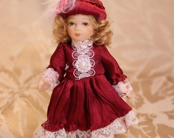 Victorian Doll Maroon Dress Porcelain Face, Arms and legs. Maroon and Lace