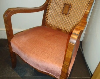 Early C20th walnut effect Art Deco cane back bergere open fireside armchair for reupholstery