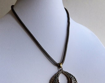 Gold Necklace with Wings and Topaz Crystals