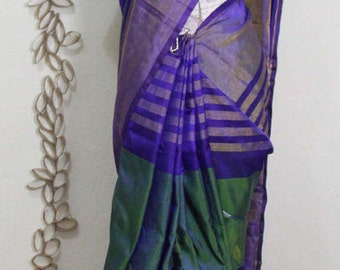 pure uppada pattu saree with the combination of ink blue and green with work blouse.