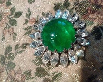 With green stone brooch