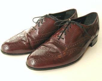 Men's Florsheim wingtip leather shoes. Cordovan / Oxblood / maroon lace-up oxfords. US size 9D.