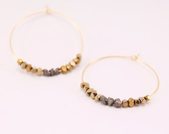 Large Creole gold end 24 K and pyrite beads
