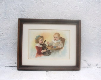 Small Framed Picture Easter Theme Two Little Girls and a Rabbit and some Colored Eggs