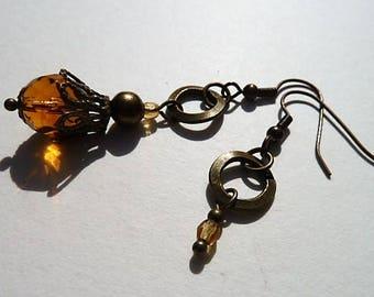 Yellow/orange and bronze asymmetric earrings